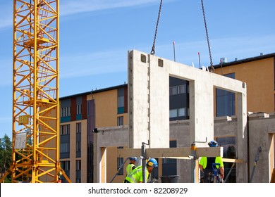 Construction site crane is used to placing precast concrete panels