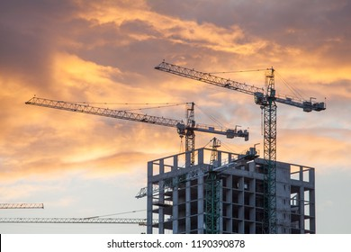 Construction site with cranes against the background of the evening sky