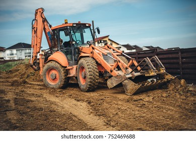 Construction site details with backhoe wheel loader excavator moving soil and earth