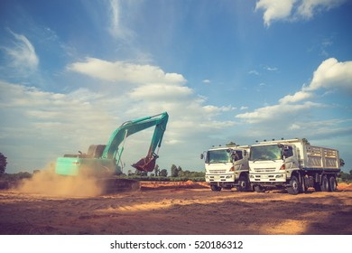 construction site digger, excavator and dumper truck. industrial machinery on building site.Vintage color