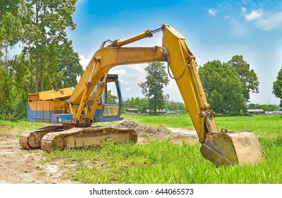 construction site digger, excavator and dumper truck. industrial machinery on building site