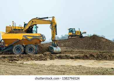 construction site with digger and truck