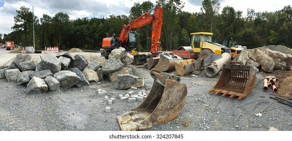 construction site with diggers machines and buckets