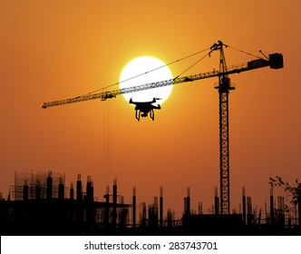 Construction Site and drone silhouette in the sunset background