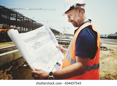 Construction Site Engineer Working Blueprint Concept