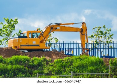 Construction Site, excavator digs the ground