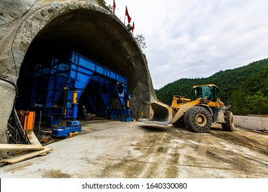 Construction site of excavator and tunnel engineering in highway construction in China