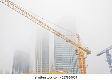 Construction site in fog, located in Qingdao City, China.
