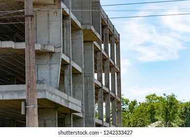 Construction site, frame of a high-rise building, empty construction. Industrial background