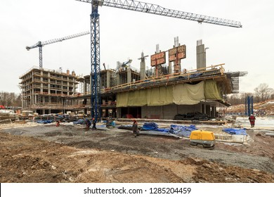 Construction site and framework of a reinforced concrete residential building. Moscow 2018 Workers fabricating steel.
