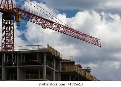 Construction site including concrete structure and crane