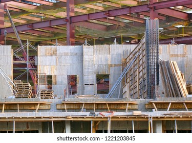 Construction site with large steel girders and timber framing