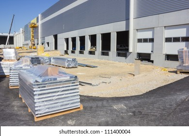 At the construction site of large warehouse