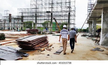 construction site, construction machinery, worker, equipment, material, steel, concrete. stadium building