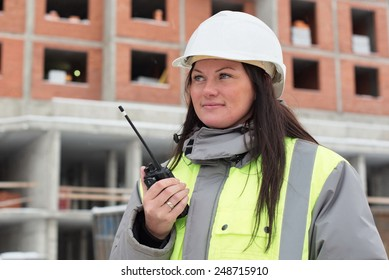 Construction site manager at at construction site is inspecting ongoing production