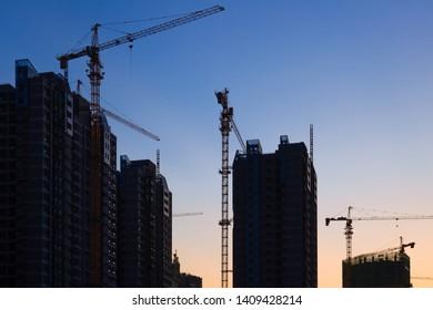 Construction site with many cranes at sunset,Fuzhou,China