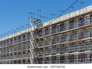 construction site of a new building with scaffolding at the outside