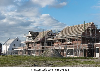 construction site of new Dutch Suburban area with modern family houses,newly bould modern family homes in the Netherlands Construction site of local homes