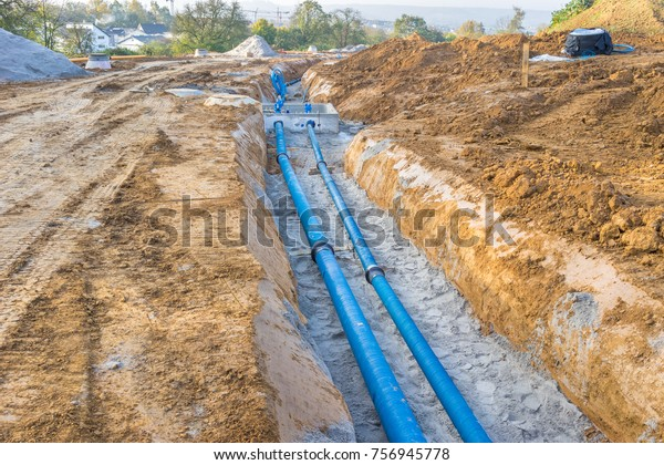 Construction site with new Water Pipes in the ground