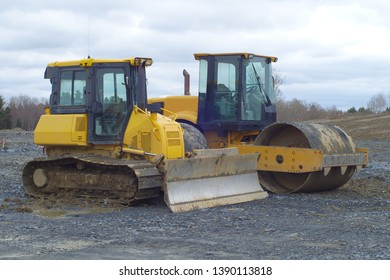 construction site paving machine yellow steamroller bulldozer