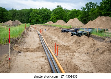Construction site with pipes in civil engineering in the construction area. Supply for gas, fiber optics, cable duct