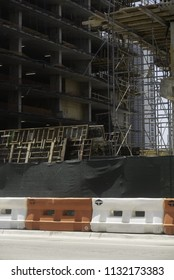 Construction site portrait with street blockades cement casts several floors scaffolding