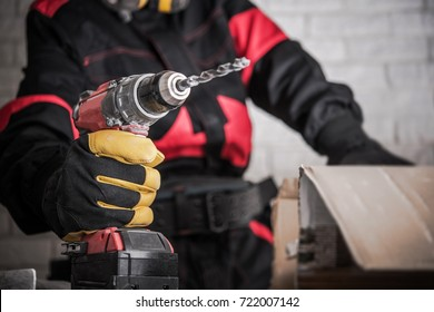 Construction Site Power Drill Tools. Contractor Worker with Powerful Cordless Drill Driver in Hand. Drilling Makes Easy Concept.