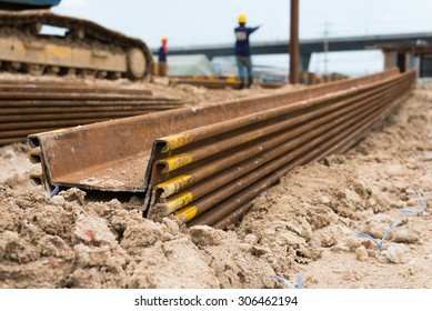 Construction site. Retaining wall steel sheet pile materials stock on construction site