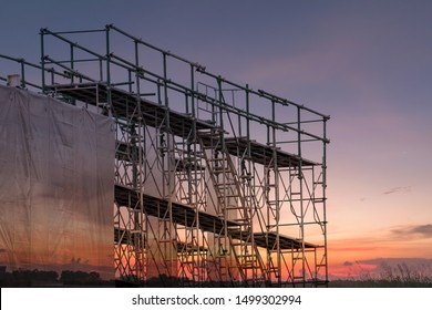 Construction site with scaffold tower and building with sunset background,scaffolding for construction factory