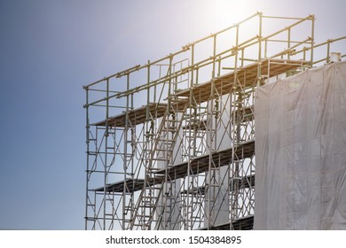 Construction site with scaffold tower and warning label building with sky background,scaffolding for construction factory