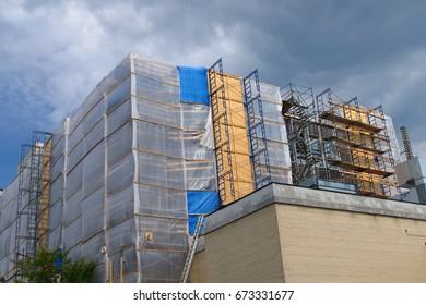 construction site scaffolding repair structure renovation reconstruction