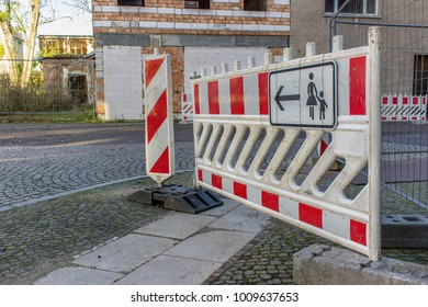 Construction site sign in the barrier at a road