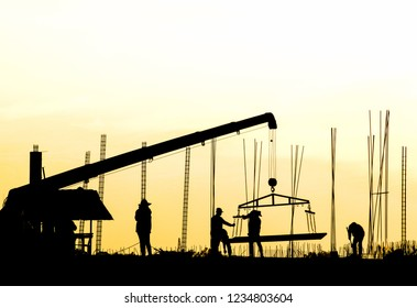Construction site silhouette,Crane over building site in the evening,shadow group worker,Dark site.