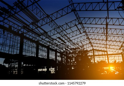 Construction site silhouettes on sunset time.