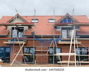 Construction site of a single house with scaffold