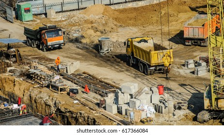 construction site from top view with trucks and bulldozer