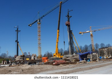 Construction site with tower cranes and Pile Boring Machine