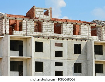 Construction site. Unfinished building with blue sky in background. Contemporary urban landscape. Developing of modern civil engineering. Construction industry. Close up