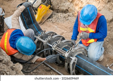 Construction site water supply project at working for welding the connecting of HDPE pipe by blue color uniform constructor