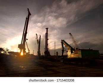Construction site whit machine or cran at dusk evening sunset background