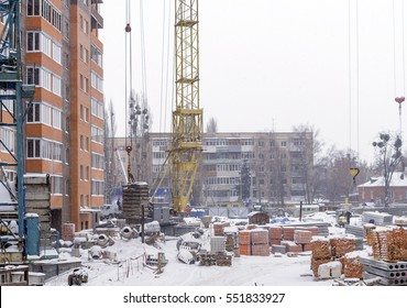 A construction site in winter snowstorm and cold weather