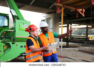 construction site workers looking at a plan