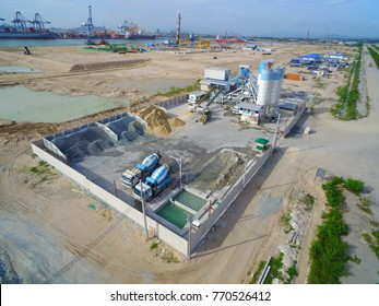 Construction site workers as show Concrete Batching Plant for support ready-mix concrete to construction all works - aerial - Top View