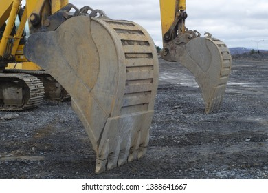 construction site yellow excavator hydrolic digging equipment shovel closeup