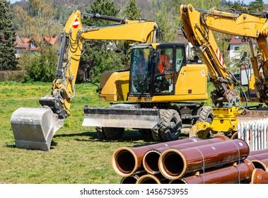 Construction site with yellow excavators