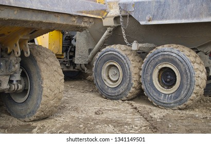 construction site yellow lorry truck wheels dirt