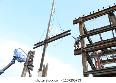 Construction site.Steel worker and steel frame.