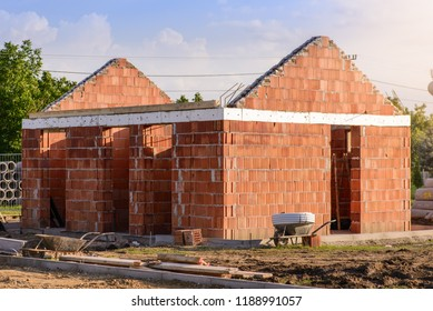 Construction of a small brick building.