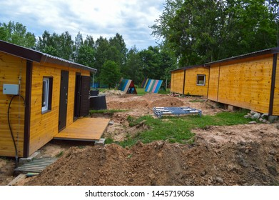 Construction of small yellow wooden frame prefabricated pre-fabricated eco-house of suburban modular fast-growing houses, buildings, cottages. Industrial builder