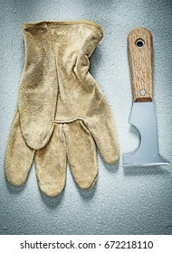 Construction spatula safety gloves on concrete background buildi